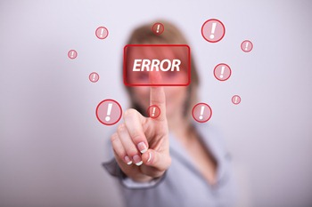 Woman pressing modern error button with one hand