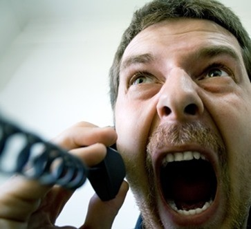 Angry stressed businessman at the phone